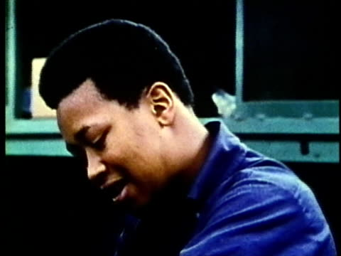 vidéos et rushes de cu, montage, various laborers working in factory, 1960's, detroit, michigan, usa - 1960 1969