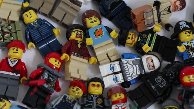 various lego pieces and figurines arranged in studio, in danbury, essex, england, u.k., on friday, march 5, 2021. - male likeness stock videos & royalty-free footage