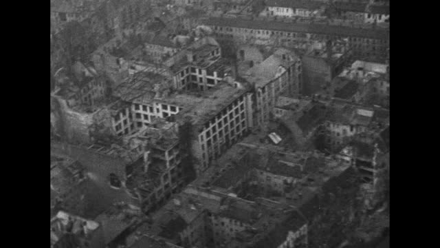 Various low level aerial shots of extensive bomb damage to Berlin from Allied bombing / Note exact day not known