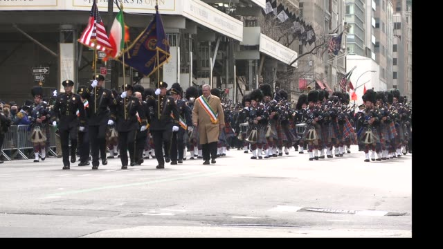 various members of different bagpiper bands from the tri-sate area march up 5th avenue during the parade - st. patrick's day stock videos & royalty-free footage