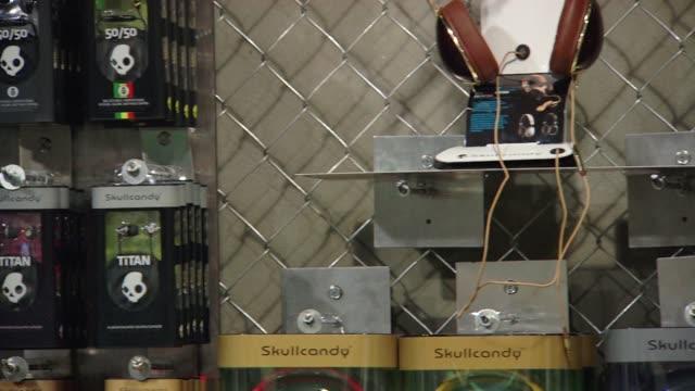 various merchandise on display / skullcandy headphones / skullcandy t-shirts / skullcandy backpacks skullcandy merchandise on november 18, 2011 in... - park city utah stock videos & royalty-free footage