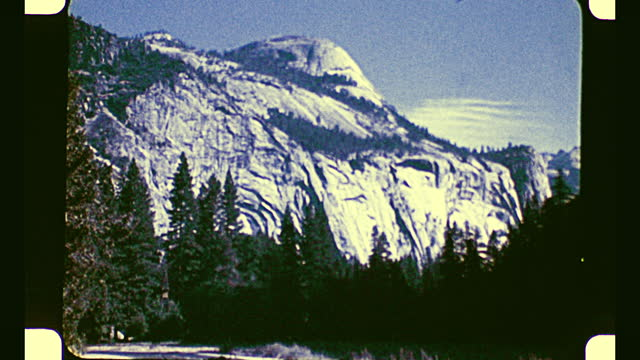 various mountains behind the forest against the sky at yosemite national park - yosemite national park stock videos & royalty-free footage