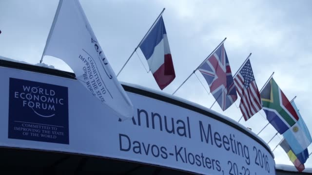 Various national flags sit above the Congress Center venue for the World Economic Forum in Davos Switzerland on Tuesday Jan 19 Members of the Swiss...
