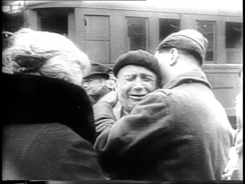 stockvideo's en b-roll-footage met various newspaper clippings about nazi atrocities / bodies lie in a pit / general dwight d eisenhower points ahead / leaders pose outside and board... - nazism