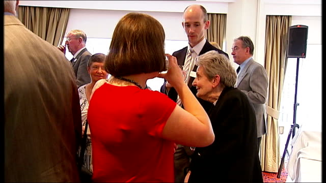 various of guests at reunion for british children who surived in nazi occupied ypres in world war ii lillian betts interview sot - they came at 4 o'... - ゲシュタポ点の映像素材/bロール
