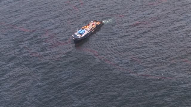 stockvideo's en b-roll-footage met various of oil sheen and floating oil in gulf aerials of boats skimming and using boom gulf oil spill aerials on july 16 2010 - bp