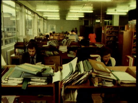 various of people working in income tax office with paper filing systems people working in income tax office on august 08 1980 - filing cabinet stock videos & royalty-free footage