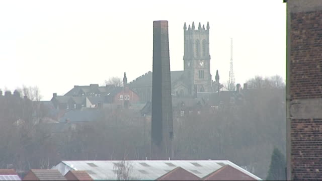 various of stoke ceramic factories stoke on trent ext traffic along dual carriageway with disused factories in distance / factory building with... - kiln stock videos and b-roll footage