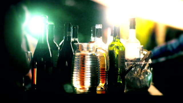 various of the alcohol bottle served at the bar counter in party at night. - bottle stock videos & royalty-free footage