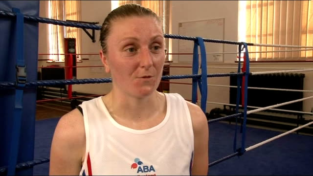 Various of women shadow boxing in gym Sharon Holford boxing punch bag / interview SOT Two women sparring in ring Woman skipping during training...