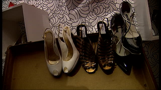 various of young women attending look fashion swap charity event tartan highheeled shoes labelled with 80 points label more secondhand shoes on... - tartan stock videos & royalty-free footage