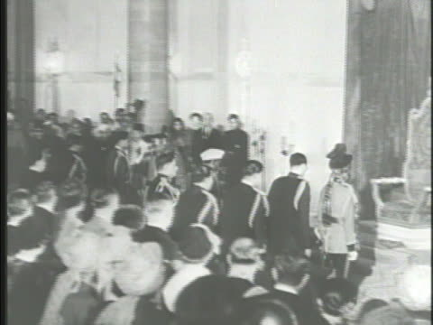 Various officials attending ceremony other attendees Indian speaker standing speaking 'the 26th day of January 1950 India shall be a sovereign...