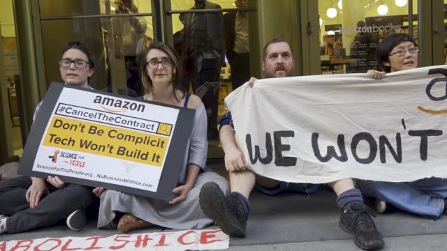 various organizations picketed and marched in front of microsoft , salesforce , and the amazon book store targeting these companies because of their... - demonstrant stock-videos und b-roll-filmmaterial