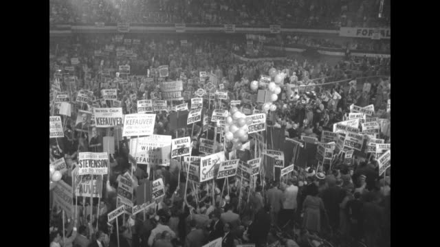 vidéos et rushes de various overhead shots of delegates demonstrating on convention floor for il gov adlai stevenson / close shot of massachusetts sign held by delegate... - adlai stevenson