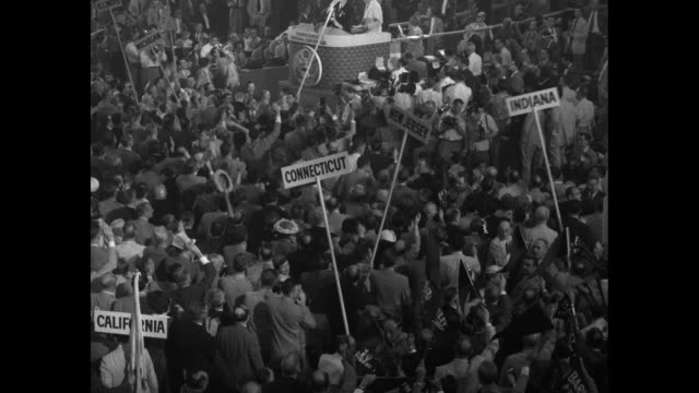 various overhead shots of democratic national convention delegates cheering applauding while vice president alben barkley stands on rostrum after... - alben w. barkley stock videos and b-roll footage