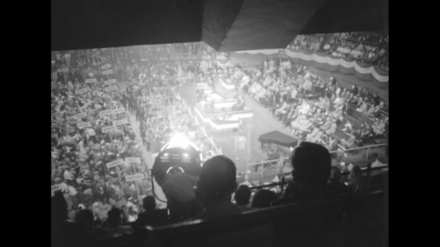 vidéos et rushes de various overhead shots of legionnaires on floor of convention in madison square garden / closer view of legionnaires sitting and applauding /... - adlai stevenson