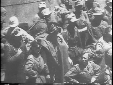various overhead views of lines of captured nazi soldiers being marched along beach / nazi officers and soldiers standing in groups / soldiers behind... - 1943 stock videos & royalty-free footage