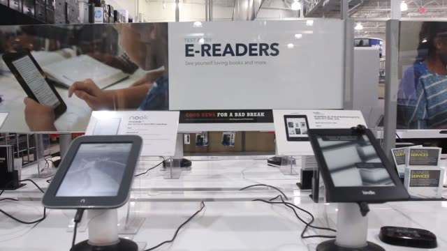 various panning shots of displays featuring the kindle and other ereaders and related signage at a best buy in northbrook illinois close up shot of a... - kindle stock videos & royalty-free footage