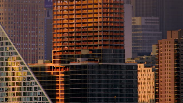 Various parallel and perpindicular lines created by New York City skyscrapers during the soft, early morning light.