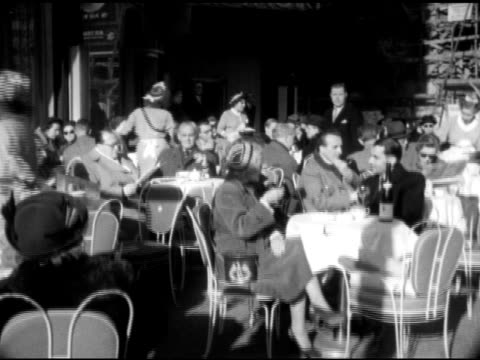 various people dining at tables in outdoor cafe restaurant drinking - west berlin stock videos & royalty-free footage