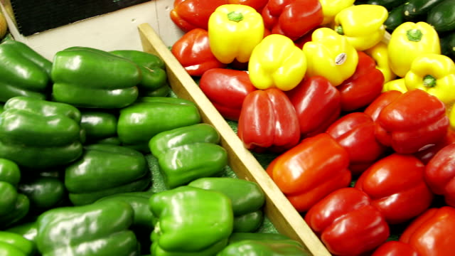 various peppers on display at grocery store - green bell pepper stock videos & royalty-free footage