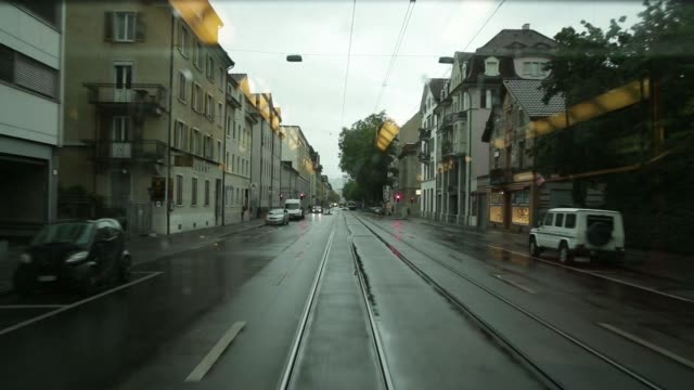 various point of view shots filmed from the rear of a tram carriage during journey along city streets between station stops in zurich switzerland on... - tram point of view stock videos and b-roll footage