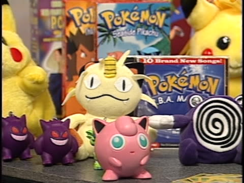 various pokemon merchandise like stuffed animals, trading cards and video games are shown. child psychologist ava siegler discusses how kids love to... - pokémon stock videos & royalty-free footage