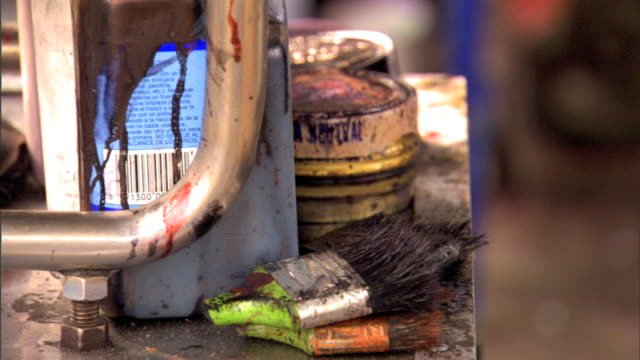MCU Various polish cans brush TU to MCU unidentifiable male shoeshiner shinning person's shoes w/ rag polish on street Boot polisher shoe polish...