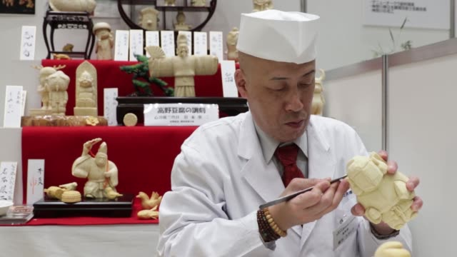 Various prepared meals sit on display at the Monozukuri Takumi no Waza Expo in Tokyo Japan on Thursday Aug 11 A mukimonostyle decorative garnish...