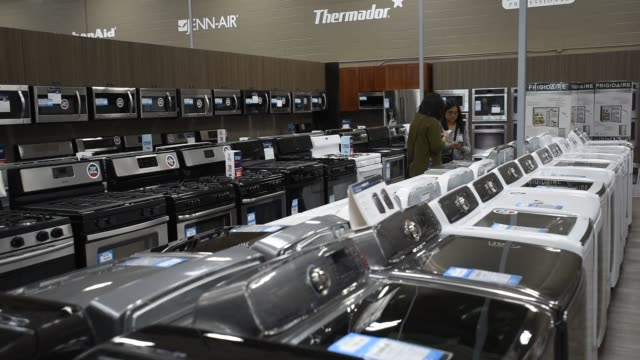 Various products and accessories on display at a Best Buy store in San Francisco CA on May 19 2015 Shots camera moves forward following worker wide...