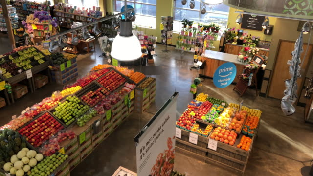 various products at the amazon's whole foods grocery store in chattanooga tennessee amazon bought whole foods for $132 billion in 2017 and has over... - orange stock videos & royalty-free footage