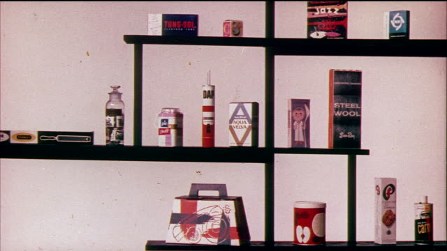 1958 montage ms various products designed by donald deskey appearing on shelf / usa / audio - anno 1958 video stock e b–roll