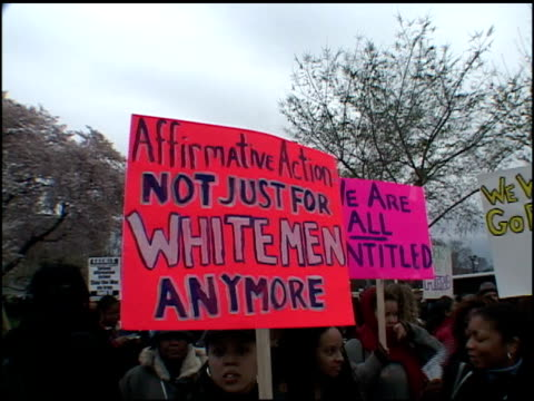 Various protesters holding signs in support of Affirmative Action and marching
