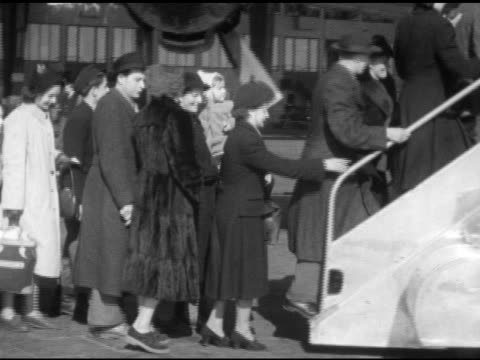various refugees men women children families lining up walking up stairs boarding airplane at tempelhof airport - flugpassagier stock-videos und b-roll-filmmaterial