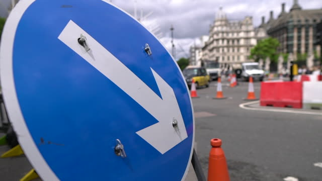 various road and traffic signs around westminster london - road sign stock videos & royalty-free footage