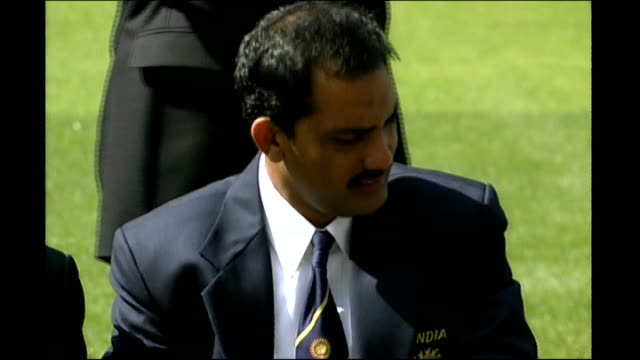 various rushes from 1990s; england: london: lords: ext captains of teams competing in the 1999 cricket world cup posing with the trophy photocall... - 1990 1999 stock videos & royalty-free footage