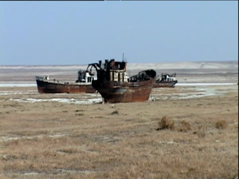 various rusty boats in former aral sea area kazakhstan - imperfection stock videos and b-roll footage