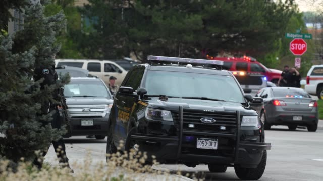 Various scenes during the aftermath of the STEM School shooting in Highlands Ranch Colorado on Tuesday May 7th 2019 Police are seen looking for...