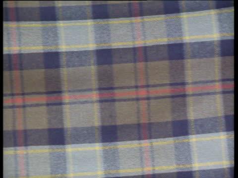 various scottish tartan fabrics - tartan stock videos & royalty-free footage