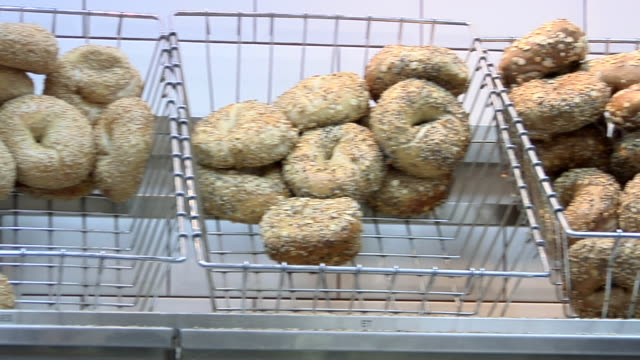 ms pan various seeded bagels for sale at street stall / new york, united states - bagel stock videos & royalty-free footage