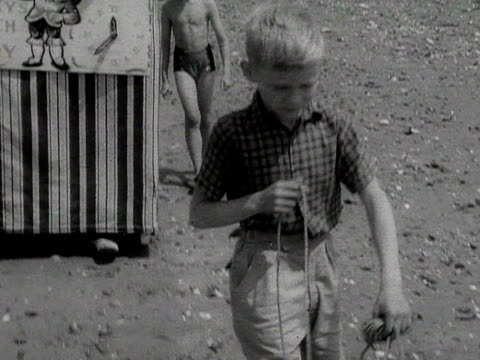 various shot of children watching a punch and judy show on the beach - puppet stock videos & royalty-free footage