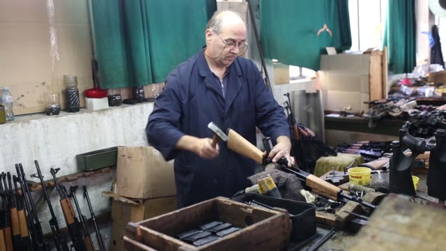 various shots a male employee works on m-70b1 automatic rifles during manufacture at the zastava oruzje ad firearms factory in kragujevac, serbia, on... - serbia stock videos & royalty-free footage