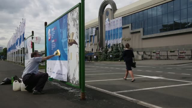 various shots a worker pastes an advertisement for the st petersburg international economic forum 2013 outside the main entrance to the lenexpo... - 2013 stock videos & royalty-free footage