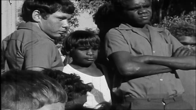 "various shots aboriginal children and adults standing around johnny cash as he sings a song about ""little children young and free"" while playing... - aboriginal australian ethnicity stock videos & royalty-free footage"