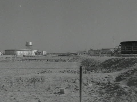various shots across a desert oil processing plant in basra iraq; 1954. - iraq stock videos & royalty-free footage