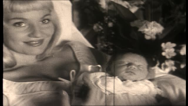 vídeos de stock, filmes e b-roll de various shots actress diane cilento in bed with newborn baby daughter giovanna volpe / close up baby / cu cilento / mother lady phillis cilento holds... - atriz