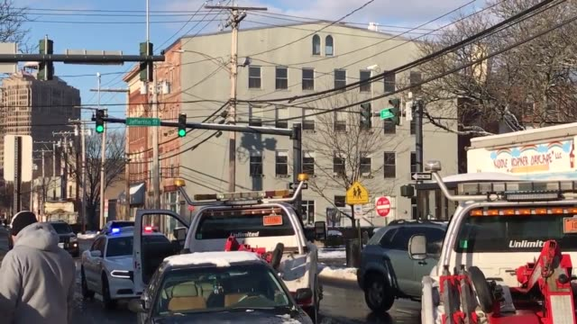 various shots along grand avenue in new haven of a driver of a black car that appears to have rear ended a first student school bus. police on scene.... - ニューヘイブン点の映像素材/bロール