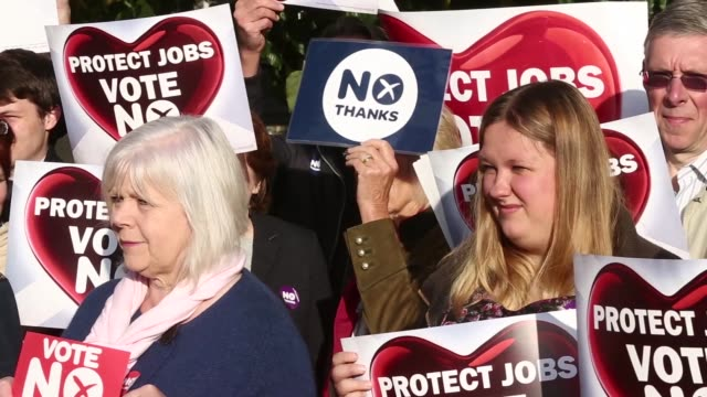 Various shots anti independence Better Together campaigners hold a banner and placards reading Protect Jobs Vote No during a demonstration in...