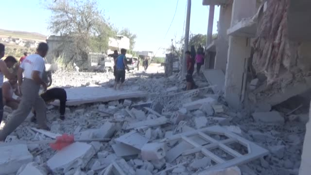 various shots as airstrikes kill ten civilians idlib in northwestern syria and local residents carries the bodies on september 04, 2018. - air raid stock videos & royalty-free footage