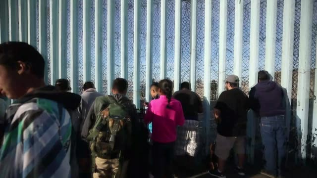various shots as migrant convoy waits at tijuana border as us border helicopters patrol at tijuana in mexico on december 03 2018 - exile stock videos & royalty-free footage